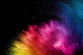 Colorful background of pastel powder.Multi colored dust splash on black background.Painted Holi.