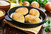 Millet burgerss in a frying pan
