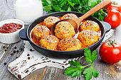 Meatballs in creamy tomato sauce
