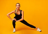 Fitness Woman Doing Side Lunge Stretch Working Out In Studio