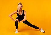 Girl Doing Side Lunge Stretching Legs, Studio Shot