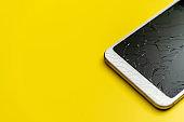 Smartphone with broken screen, close-up