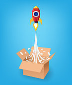 Think outside the box business concept, Paper art style of red rocket flying from the opening box on blue background