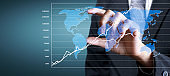 Hand touching a graphs of financial indicator accounting market economy analysis chart