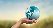Globe ,earth in human hand, holding our planet glowing