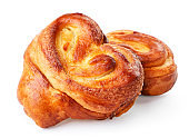 Buns made of yeast dough in the form of a heart on a white background. Isolated