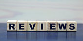 concept word reviews on cubes on a beautiful wooden background