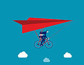 Businessman ride hang gliding. Flying concept