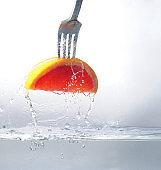 a slice of grapefruit on a fork