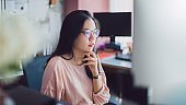 Asian young business woman working from home office.New normal lifestyle concept of lockdown, quarantine and social distancing to stop the spread disease of Coronavirus.Remote work online technology.
