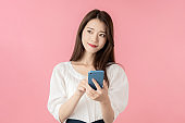 Young girl using a smart phone.