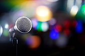 Microphone on a black background with colorful lights and flares