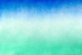Blue and green abstract watercolor paint on texture paper background. Spring summer concept.