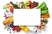 Large group of groceries with copy space against white background