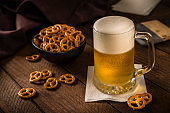 Beer and pretzels on a rustic wooden table
