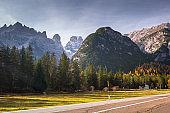 Idyllic road through the Dolomites mountains