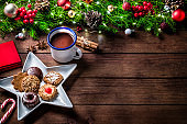 Christmas cookies and hot chocolate with copy space on a rustic wooden table