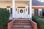 Front Porch and door decorated for the Christmas holiday season