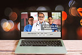 Booking online appointment with doctor on laptop