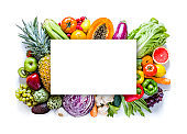 Large group of multicolored fruits and vegetables with copy space against white background