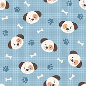 Pattern with cartoon puppies, bones and dog paws on blue grid background
