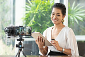 Young student woman use wireless internet learning and co-working at home on mobile tablet app. Modern girl people blogger couch on laptop education classroom online device, Social distancing in space