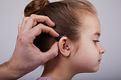 Hearing Aid in Young Girl's Ear