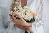 bride in a wedding dress with a bouquet