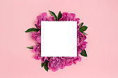 Square paper card mockup on a pink pastel background.