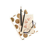 Composition with notepads, stationery and glasses