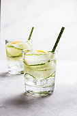 Nutritious detox water with lemon and cucumber in a glass.