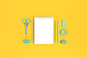 Notepad template with mint stationery on a bright yellow background.