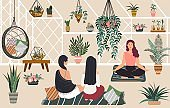 People relax yoga and meditation in greenhouse hygge home, women