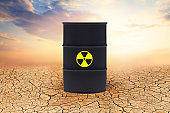 Radioactive waste barrel against sky clouds. Radioactive waste barrels. Environment protection and toxic nuclear pollution concept