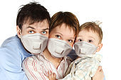 Family wearing protective mask on white