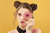Young woman and donut, fashion portrait