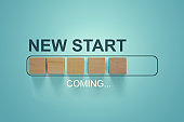 Wooden blocks with the word NEW START coming in loading bar progress.