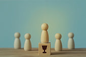 Successful business team leader concept: Businessman standing at the highest point on wooden block stand out from the crowd. depicts of career growth up or business success.