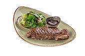 Grilled Beef Steak with tomato sauce and fresh vegetable salad isolated on white background
