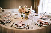 elegant table setting for a wedding banquet, pastel beige decorations