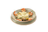 Healthy Grilled Caesar Salad with shrimp, parmesan Cheese and Croutons on grey plate isolated on white background