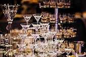 Pyramid of martinis glasses on a cocktail reception on wedding party