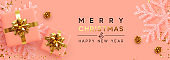 Christmas banner. Background Xmas design of realistic gifts box, pink snowflake and glitter gold confetti. Horizontal poster, greeting card, headers, website. Decoration objects flat lay, top view