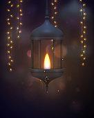 Vintage dark blue lantern with a burning realistic fire