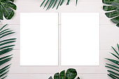 Blank paper sheet copy space with mockup and leaf on wooden table, poster and invitation, postcard decoration your design or branding, simplicity and minimal, nobody, flat lay, top view.