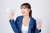 Beautiful portrait young business asian woman holding money isolated on white background, businesswoman showing banknotes with excited, happy girl income with profit finance and success concept.