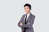Portrait young asian business man call center wearing headset isolated on white background, agent with support and service, businessman is assistant for client with phone or helpline online.
