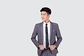 Portrait young asian businessman in suit smiling with confident and friendly isolated on white background, business man smart with success, manager or executive with handsome and leadership.