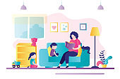 Nanny reading book for little children. Concept of home kindergarten and babysitting. Mother with kids in living room. Woman communicates with boy and girl
