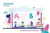 Teacher explaining alphabet to children. Concept of nursery school. Kids sit at desk and gain new knowledge
